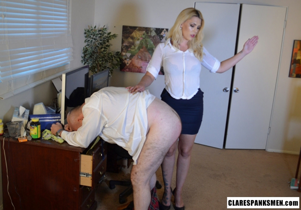 He bends over the desk and gets his bare bottom spanked by strict and sexy Bella Bathory