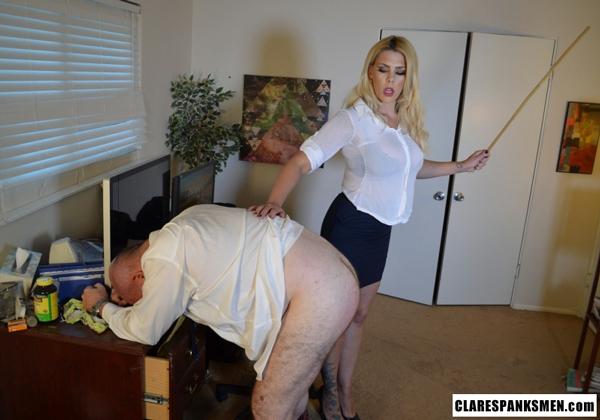 Bella Bathory canes the lazy, useless man over his desk