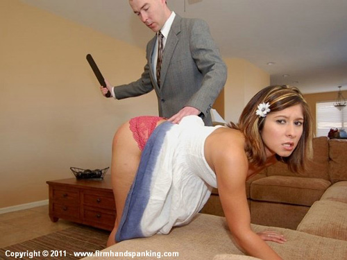 Bratty princess, Michaela McGowen bends over in the livingroom for a dose of the strap on her plump bottom