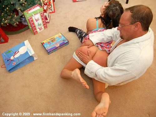 Bratty Samantha Woodley gets a Xmas morning spanking on her bare bottom