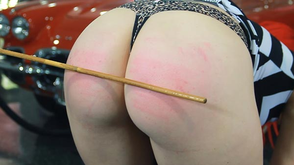 Alison Miller touches her toes for the cane