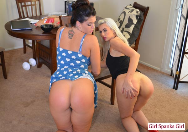 Allison Tyler and Gigi Allens show off their big spanked bottoms before lesbian kissing each other