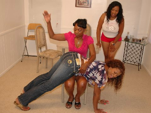 Lana gets to grips with Sydnee Capri and Kandi Kream in an all-ebony spanking movie