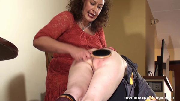 Melody Nore is spanked hard over the knee with a hairbrush in Prank Punishment