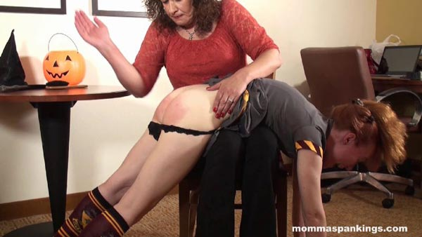 Melody Nore gets her bare bottom spanked hard by Miss Chris in this Halloween spanking
