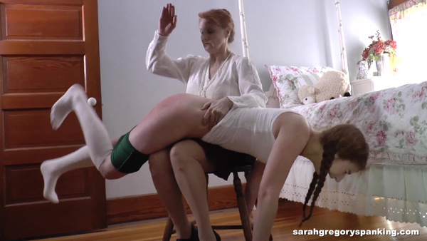 Tasha Lee gives Bianca Rose a hard OTK hand spanking