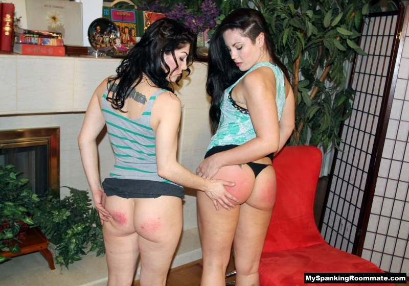 Kay Richards and Madison Martin examine each other's well-spanked bottoms