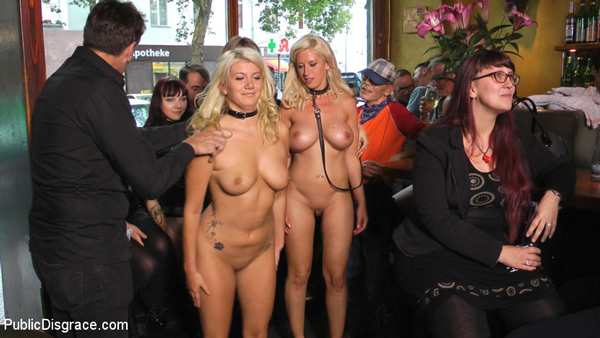 Two naked and collared blondes, Laela Pryce and Manu Magnum, get taken to a bar