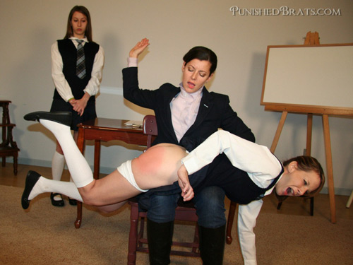 Schoolgirl Pixie gets spanked OTK by teacher Beverly Bacci in the classroom