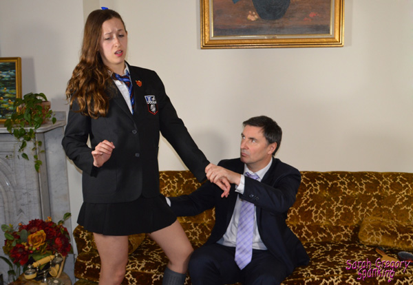 Joelle Barros gets pulled over John's knee in her school uniform