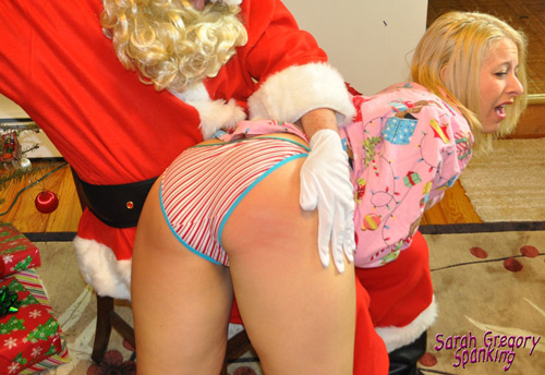 Naughty blonde Sarah Gregory gets her big bottom spanked hard by Santa OTK