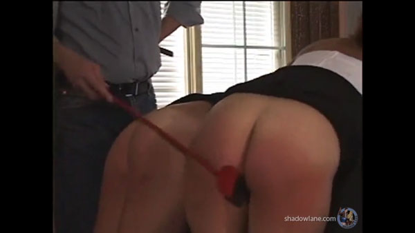 Claude uses the riding crop on the two bare bottoms