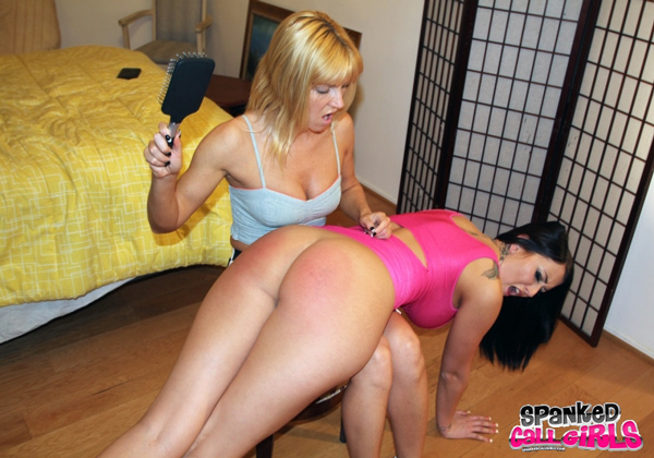 Niki gets her own back and spanks Alexis Grace with a hairbrush