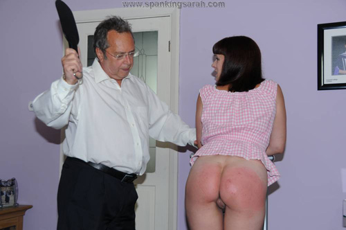 Leia Ann Woods gets paddled on the bare bottom