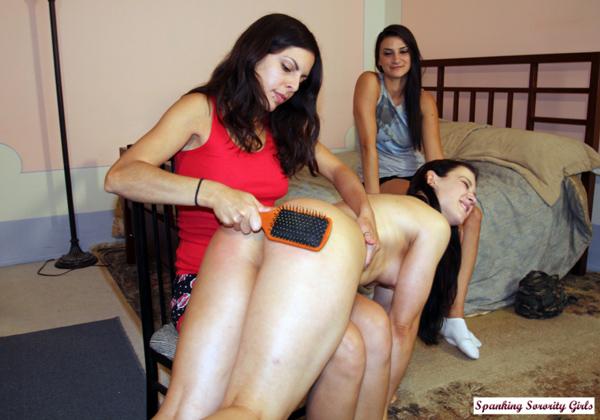 Spanking her naked