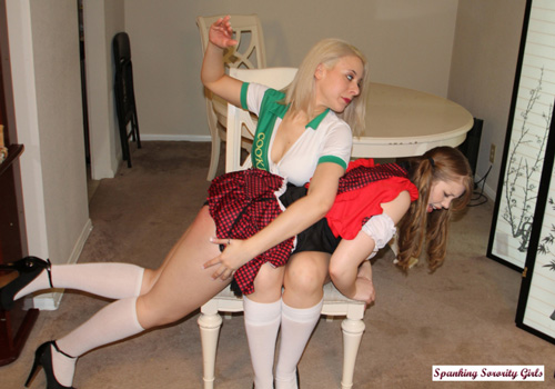 Pretty brunette Christy Cutie gets her big bottom spanked by Sarah Gregory