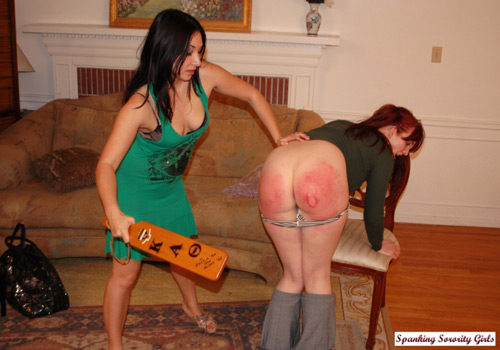 British pornstar Roxy Jezel gives Veronica a spanking with the sorority paddle