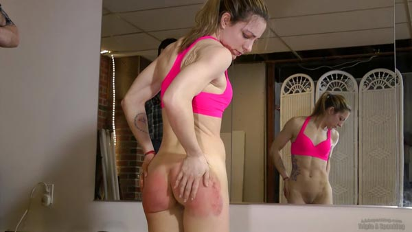 Lily Swan inspects her very sore, red and marked bottom