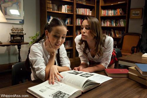 Amber Rayne spanks submissive classmate Amai Liu in class