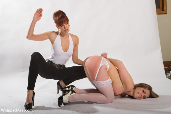 With her bare ass high in the air sexy Courtney Cummz gets spanked by Maitresse Madeline
